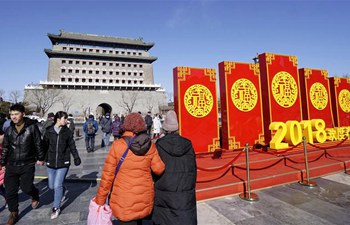 Tourists visit Qianmen street to enjoy scenery and delicacies