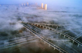 Fog envelops Zhouyu Overpass of National Highway 206