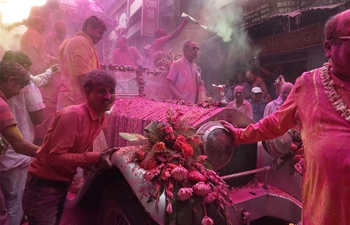 People celebrate Holi on eve of Holi Festival in India