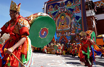 People attend religious service at Qoide Monastery in China's Tibet