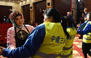 Female construction workers invited to experience Peking opera