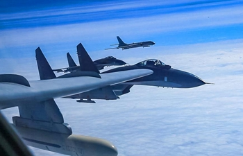Chinese air force conducts high-sea training