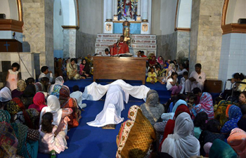 Pakistani Christians attend Good Friday service at church in Lahore
