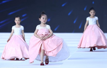 Creations designed by Xu Xinyin presented at China Fashion Week in Beijing