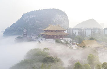 Scenery of advection fog above Liujiang River in Liuzhou, S China