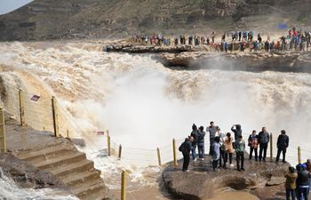 Tourists visit Hukou Waterfall of Yellow River