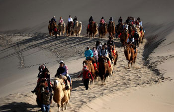 Tourists visit Mingsha Mountain, Crescent Spring scenic zone in Dunhuang