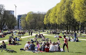 People enjoy sunshine as temperature rises in Brussels