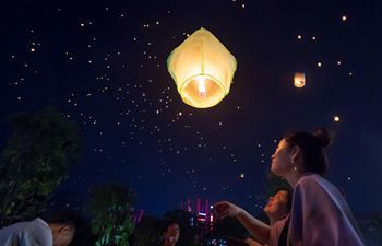 People fly Kongming lanterns in Jinghong, SW China's Yunnan