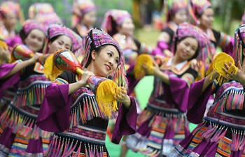 "People of ethnic minorities welcome ""San Yue San"" festival in south China"