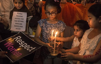 Candle light march held to protest against rape and murder of eight-year-old girl in India