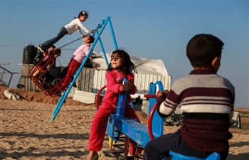 Palestinian children play near border between Israel, Gaza Strip