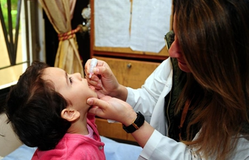 Children receive vaccine in Damascus, Syria
