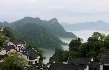 Tourists enjoy misty scenery across China