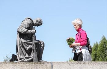 "People commemorate ""Victory in Europe Day"" at Soviet War Memorial, Berlin"