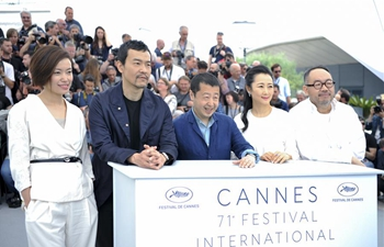 "Cast members of film ""Ash is Purest White"" pose at Cannes Int'l Film Festival"