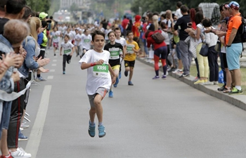 Boys compete in half-Marathon kids race in Bucharest, Romania
