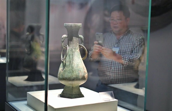 Visitors view exhibits at Guizhou Provincial Museum