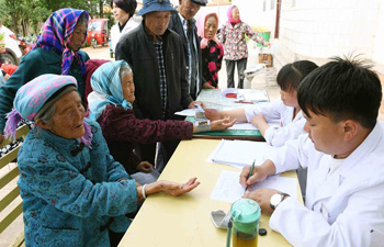 Medical treatment provided to impoverished villagers in SW China's Yunnan