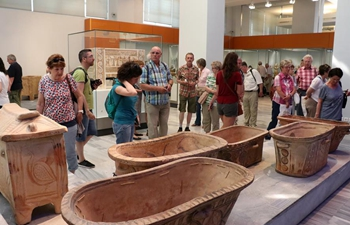 Tourists visit Heraklion Archaeological Museum in Crete, Greece