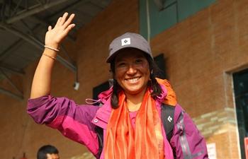Nepali Photojournalist scales Mount Qomolangma