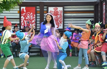 Pupils display fashion clothes made from wastes in Shijiazhuang, N China