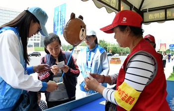 Volunteers offer services for upcoming SCO summit in Qingdao