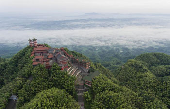 Scenery of clouds above bamboo forests and rural residence in China's Sichuan