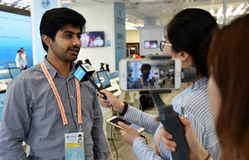 In pics: journalists at SCO Qingdao summit