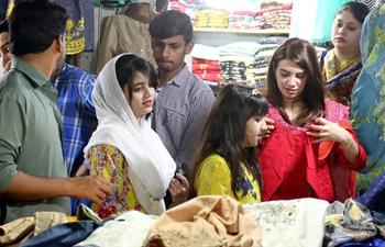 People go shopping ahead of Eid al-Fitr in Islamabad, Pakistan