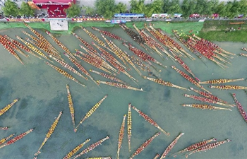 People participate in dragon boat races across China