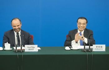 Chinese premier, French PM attend entrepreneurs symposium