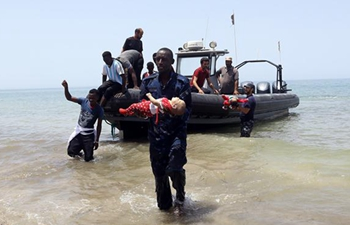 100 migrants feared dead after boat capsizes off Libyan coast