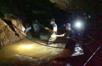 Rescuers search for Thai footballers, their coach missing in cave