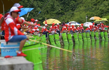 Contestants take part in fishing competition in central China's Hubei