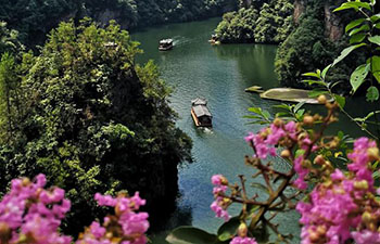 Tourists go sightseeing on boat in Zhangjiajie, China's Hunan