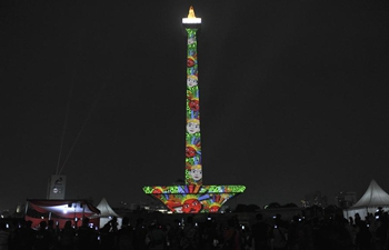 Video mapping projected on Indonesia's National Monument to welcome Asian Games