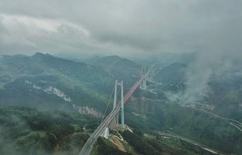 Fog-shrouded Qingshuihe bridge in southwest China's Guizhou