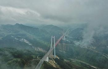 Fog-shrouded Qingshuihe bridge in southwest China's Guizhou