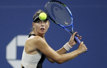 US Open: Sharapova beats Schnyder 2-0