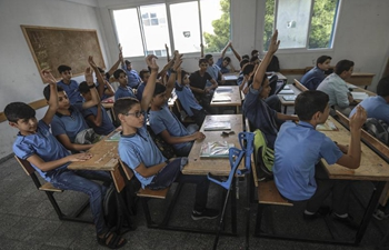 In pics: Palestinian refugee students in northern Gaza Strip