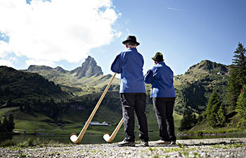 Participants take part in Alphorn meeting at Seebenalp, Switzerland