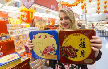Customers buy mooncakes before Mid-Autumn Festival in Toronto