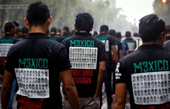 People take part in commemorative march in Mexico City