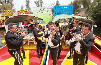 "Tourists ride ""trajineras"" through canals of Xochimilco in Mexico City"