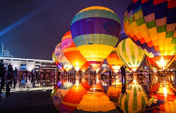 People view colorful hot air balloons in China's Guizhou