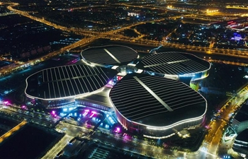 Night view of National Exhibition and Convention Center in Shanghai