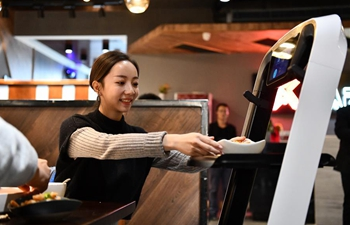 Robots serve food in smart restaurant in Tianjin