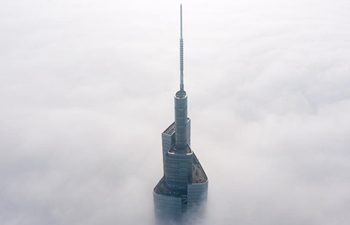 450-meter-high skyscraper piercing through fog in Nanjing