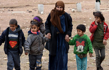 Families return to their homes in government-held areas in northern Syria